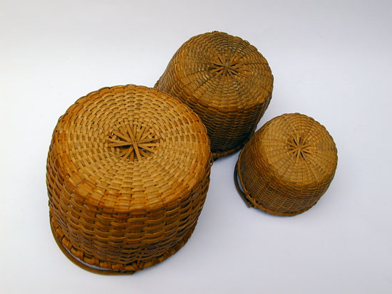 An Assembled Stacking Set of 3 Bale Handled Baskets