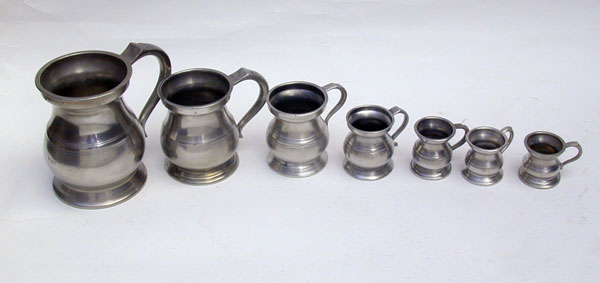 An Assembled Set of Enlish Pewter Bellied Pub Measures