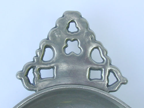An Unmarked English or American Geometric Handle Porringer