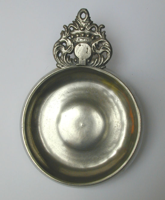 A Wide Bellied Crown Handle Porringer